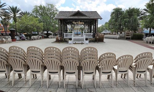 A photo of chairs stacked in a deserted town square in The Villages, Florida's biggest retirement community.